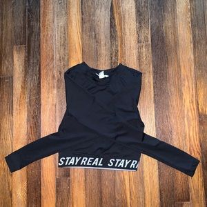 Black fitted crop top w STAY REAL logo branding